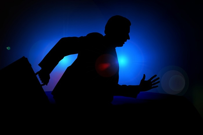 Silhouette of Man Trying to Escape