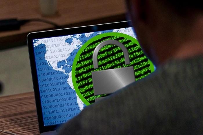 User Looking At Laptop Displaying Encryption