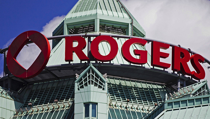 The Rogers sign is seen atop the Rogers Communications headquarters building in Toronto