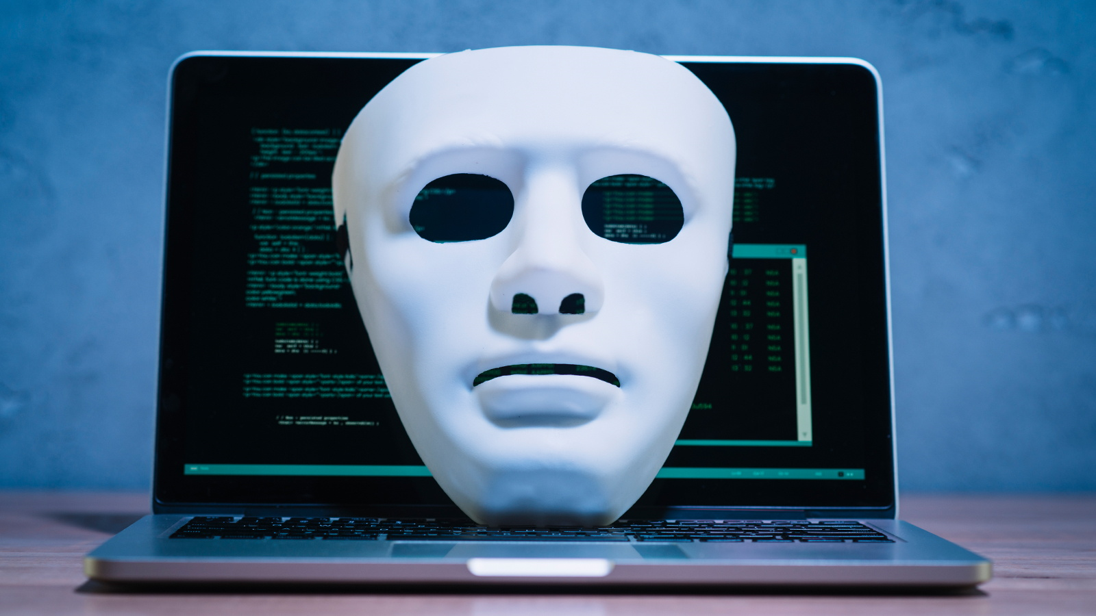 Hacker Mask on Computer