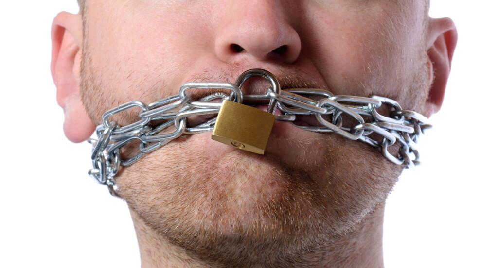 Man Silenced with Chains