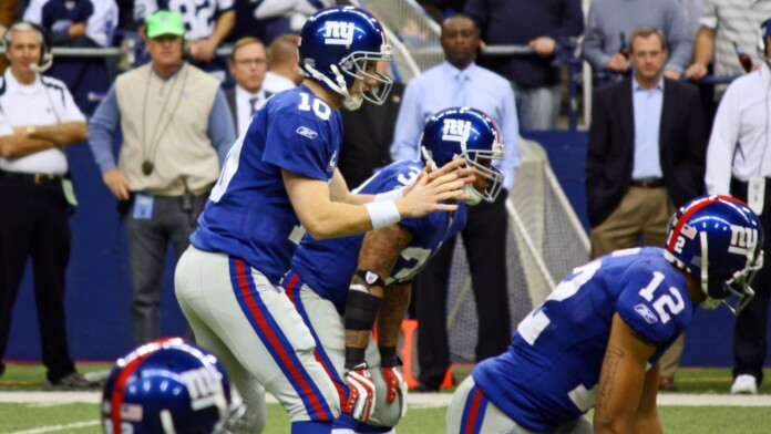 NY Giants Quarterback Eli Manning prepares to receive the snap from center during a game with the Dallas Cowboys